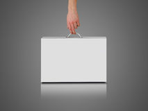 Hand holds a white box with a handle. Packing box for laptop. Isolated on grey background Stock Image