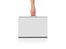Hand holds a white box with a handle. Packing box for laptop. Stands on a reflection floor. Isolated on white background Royalty Free Stock Photo