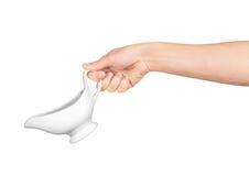 Hand holds white gravy boat Stock Images