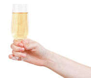 Hand holds wineglass with sparkling wine Stock Images