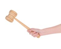 Hand holds Wooden meat mallet Stock Photo
