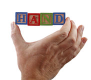 Hand holds word Stock Photography