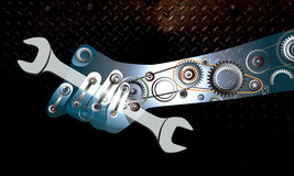 Hand holds a wrench. Stock Images