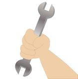 Hand holds a wrench Royalty Free Stock Photo