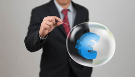 Hand hole needle with euro symbol in bubble Royalty Free Stock Photo