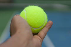 Hand hole tennis ball Stock Images