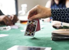 Hand holing card in a gambling game Stock Photography