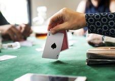 Hand holing card playing a gambling Royalty Free Stock Photography