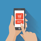 Hand holing smart phone with buy button on the Royalty Free Stock Photography