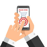 Hand holing smart phone with buy button on the screen Using Stock Photography