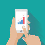 Hand holing smart phone with increasing bar chart Royalty Free Stock Image