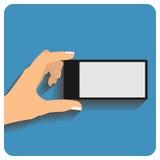 Hand holing smartphone Stock Photo