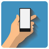 Hand holing smartphone Stock Images