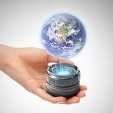 Hand with holographic projector Royalty Free Stock Image