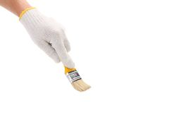 Hand hols of a paint brush. Royalty Free Stock Photography