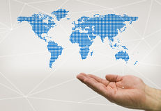 Hand honding the world. In blue color royalty free stock photography