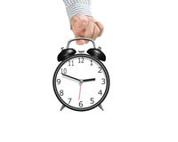 Hand hooking alarm clock Royalty Free Stock Images