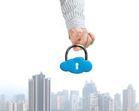 Hand hooking cloud shape lock with city view Royalty Free Stock Photos