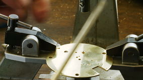 Hand of horologist using screwdriver. In the workshop stock footage
