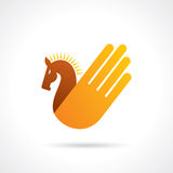 Hand with horse - creative icon Stock Image