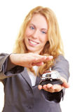 Hand on hotel bell. Woman in a business suit with hotel bell royalty free stock images