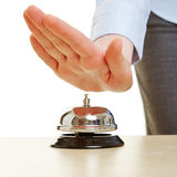 Hand on a hotel bell Royalty Free Stock Image