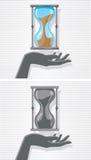 Hand and hourglass Stock Photo
