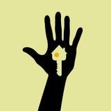 Hand hous  key. Hand holding a house key Stock Photos