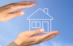 Hand house Stock Image