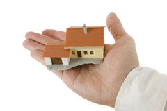 Hand with house. Businessman hand with a little house Stock Photography