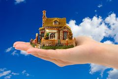 Hand and house Royalty Free Stock Photo