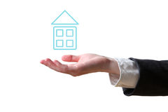 Hand and house. Business concept (isolated on white background royalty free stock photography