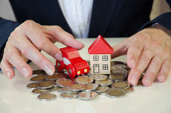 Hand, house, car and coins Stock Image