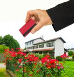 Hand with house and credit card, buy house concept royalty free stock image