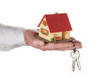 Hand with house and key Stock Photos
