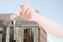 Hand with a house key in closeup Royalty Free Stock Photography