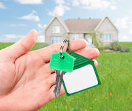 Hand with house key. Stock Images