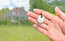 Hand with house key. Royalty Free Stock Photos