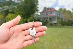 Hand with house key. Royalty Free Stock Image