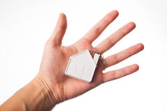 Hand with house keychain Stock Images