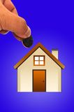 Hand with house Stock Images