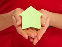 Hand with house sticky note. Stock Photos
