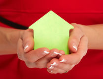 Hand with house sticky note. Royalty Free Stock Images