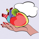 Hand with human cartoon heart made in style pop art. Vector illustration design for comics, posters, flyers, postcards Royalty Free Stock Photos