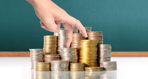 Hand human hand putting coin to money Stock Image