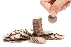 Hand human hand putting coin to money Stock Images