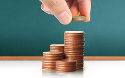 Hand human hand putting coin to money Royalty Free Stock Photos