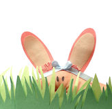 Hand Humor. Hand puppet Easter bunny hiding in some construction paper grass Royalty Free Stock Image