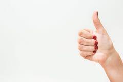 Hand i gesten av likheten som ger upp tummen Arkivfoton