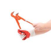 Hand i handskar som rymmer skiftnyckeln Fotografering för Bildbyråer